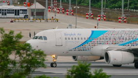 Bangkok Air Airbus 320 taxiing stock footage