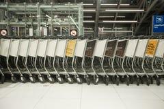 Bangkok airport. BANGKOK - JANUARY 17. Stacked empty trolleys in early morning Bangkok airport on January 17, 2012. Suvarnabhumi airport is world's 4th largest Royalty Free Stock Image