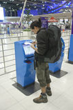 Bangkok airport. BANGKOK - JANUARY 17. Passenger completing web check-in at Bangkok airport on January 17, 2012. Suvarnabhumi airport is world's 4th largest Royalty Free Stock Photos