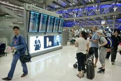 Bangkok airport. BANGKOK – JANUARY 17. People in front of departures board of Bangkok airport on January 17, 2012. early morning. Suvarnabhumi airport is world Stock Photography
