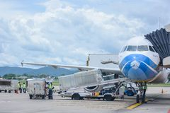 Bangkok Airways plane loading baggage and ready to fly. Chiangmai, Thailand - September 06, 2016 : Bangkok Airways plane loading baggage and ready to fly at Royalty Free Stock Photos