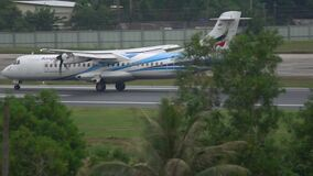 Bangkok Airways turboprop airplane. PHUKET, THAILAND - DECEMBER 1, 2016: Bangkok Airways ATR-72 HS-PZE approaching and landing in Phuket airport. Slow motion stock video footage