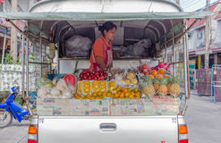 BANGKOK - April,14 : The fruit seller are preparing many kind of fruits for selling Stock Image
