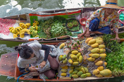 BANGKOK – APRIL 19: Merchant and customer on Wooden boats at Klong Lat Mayom Float Market Royalty Free Stock Image