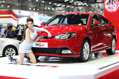 BANGKOK - August 19: MG6 car with unidentified model on display Stock Photos