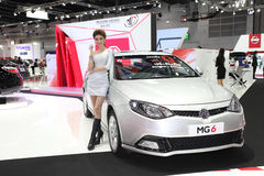 BANGKOK - August 19: MG6 car with unidentified model on display Royalty Free Stock Photos