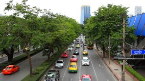 BANGKOK 2014 August 2. Traffic moves along a busy. BANGKOK 2014 August 2 THAILAND. Traffic moves along a busy city centre road of the Thai capital stock footage