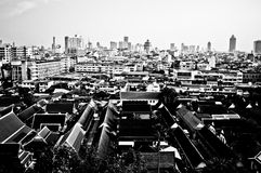 Bangkok. Black and white view from a Buddhist temple looking across the monk's quarters and Bangkok's China town Royalty Free Stock Photo