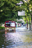 Bangkok bus run through flooded road Royalty Free Stock Photography