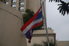 Flag of Thailand waving in front of modern buildings in Bangkok. Bangkok is the capital of Thailand and in this photo some modern buildings as well as Thailand`s stock images