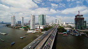 Bangkok and the chao phraya river crossed by modern motorway system in time stock footage