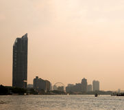 Bangkok Chao Phraya riverside scenery with ferris wheel Royalty Free Stock Photo