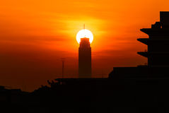 Bangkok citiscape with sunrise at the top of building Stock Photography