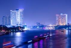 Bangkok city building at night.river in city. Stock Image