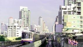 Bangkok city buildings and skytrain. Buildings and transportation in Bangkok; skytrains, traffic jam on the street Stock Image