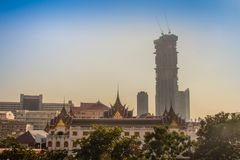 Bangkok, the city of contrasts. Ancient temple stand with new hi-rise condominium building construction. stock photo