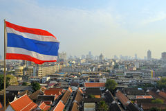 Bangkok city by day view with Thai flag Stock Images