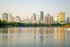 Bangkok city downtown at dusk. With reflection of skyline, Thailand Stock Photos