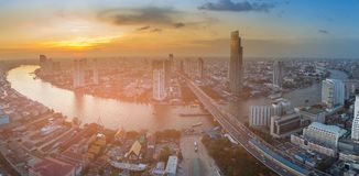 Bangkok city downtown sunset skyline over river curves, aerial view. Cityscape background stock images