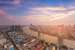 Bangkok city river curved and downtown aerial view with beauty sun light effect Stock Photo
