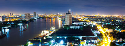 Bangkok city sky at night beside Chaophraya River. Panoramic skyline photo shot at night in bangkok thailand on a top of building see the city and chaophraya Stock Photo