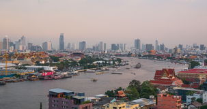 Bangkok City Skyline and Chao Phraya River from Day to Night. Timelapse day to night of Bangkok city skyline and Chao Phraya river stock video footage