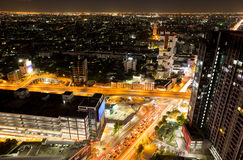Bangkok city with traffic light and high building at night time Stock Photography