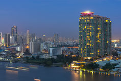 Bangkok cityscape. Bangkok river side with light of Yacht at twi Stock Photos