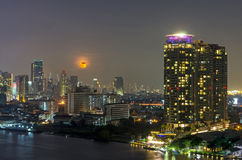 Bangkok cityscape. Bangkok river view with full moon at night Royalty Free Stock Images