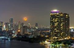 Bangkok cityscape. Bangkok river view with full moon at night Royalty Free Stock Images