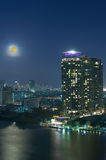 Bangkok cityscape. Bangkok river view with full moon at twilight Royalty Free Stock Image