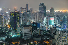 Bangkok Cityscape, Business district with high building at dusk Stock Photos