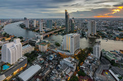Bangkok cityscape and Chaophraya River. With sunset Stock Images