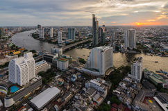 Bangkok cityscape and Chaophraya River. With sunset time Royalty Free Stock Image