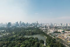 Bangkok cityscape in the morning with park in below, blue sky and cloud Stock Photography