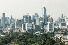 Bangkok cityscape in the morning with park in below, blue sky and cloud Stock Photo