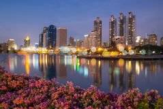 Bangkok cityscape reflect with lake Stock Image