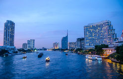 Bangkok cityscape with river and boat at night time Royalty Free Stock Photography