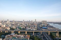 Bangkok Cityscape beside river during twilight time royalty free stock images