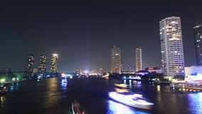 Bangkok cityscape skyscraper on the river, busy traffic river city, time lapse stock video footage
