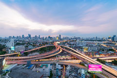 Bangkok cityscape. Traffic on the freeway in the business district. Sunset scene of Bangkok cityscape with blue sky and clouds. Traffic on the freeway in the royalty free stock photography