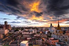 Bangkok cityscape at twilight with Wat Traimit & x28;temple of golden. Buddha& x29; is landmark of bangkok in china town area Bangkok, Thailand Royalty Free Stock Photos