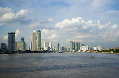 Bangkok in clear day through Chao Phraya river Royalty Free Stock Photos