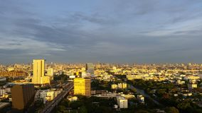Bangkok with cloud sky and golden sunlight , veiw of road and canel in the morning time from outside Stock Photography