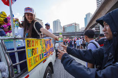 BANGKOK-DEC 22: Unidentified Thai protesters raise banners to re Royalty Free Stock Photo
