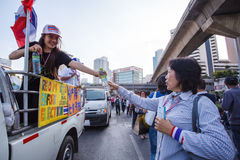 BANGKOK-DEC 22: Unidentified Thai protesters raise banners to re Royalty Free Stock Image