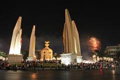 BANGKOK - DEC 5: King's Birthday Celebration - Thailand 2010. BANGKOK - DEC 5: Fireworks behind the Democracy Monument on Ratchadamnoen Road for the King's Stock Image