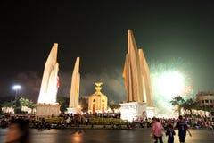 BANGKOK - DEC 5: King's Birthday Celebration - Thailand 2010. BANGKOK - DEC 5: Fireworks behind the Democracy Monument on Ratchadamnoen Road for the King's Stock Photo