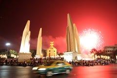 BANGKOK - DEC 5: King's Birthday Celebration - Thailand 2010. BANGKOK - DEC 5: Fireworks behind the Democracy Monument on Ratchadamnoen Road for the King's Stock Images
