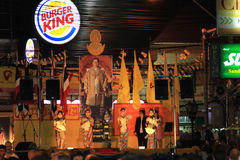 BANGKOK - DEC 5: King's Birthday Celebration - Thailand 2010. BANGKOK - DEC 5: Authentic Dressed Thai Girls Traditional Dance Show on Khao San Road for King's Stock Photo